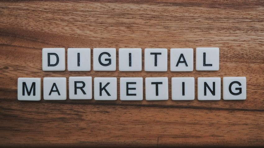 "letters that spell ""digital marketing"" on a wood background"